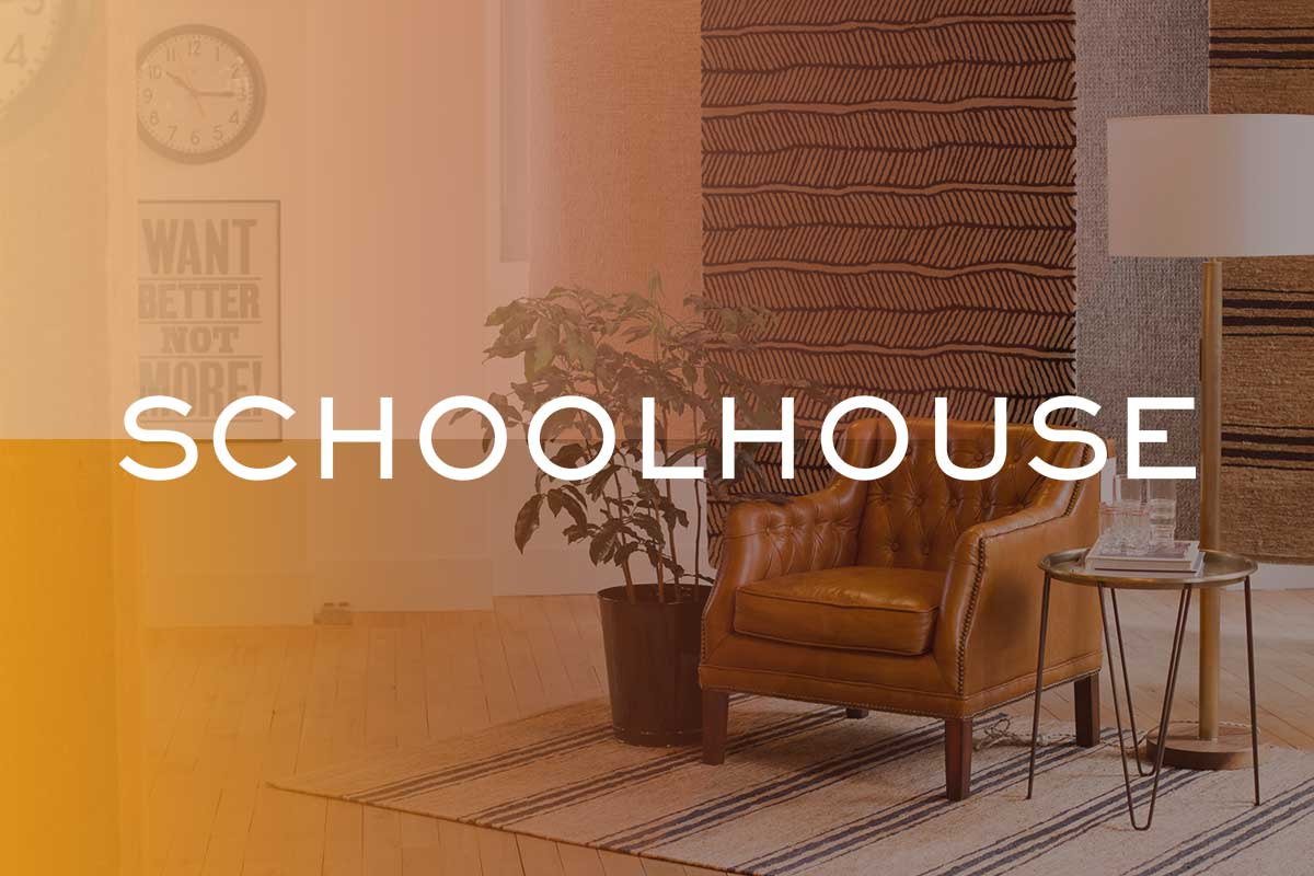 Schoolhouse logo on image of styled living room